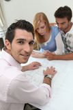 Couple looking at property plans Stock Images