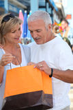 Couple looking at a purchase Stock Photography
