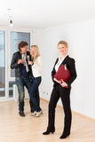 Couple looking for real estate with female realtor Stock Photos