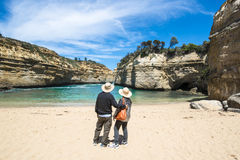 Couple looking through Rocks to Ocean, Australia. Couple in a Bay at the Twelve Apostles on Great Ocean Road in Southern Australia royalty free stock photography