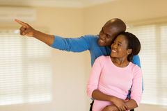 Couple looking round house Stock Photo