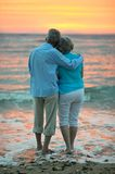 Couple looking at sea Stock Photo