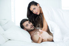 Couple looking shocked while romancing. At home Royalty Free Stock Photography