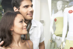 Couple Looking at Shop Window Stock Photos