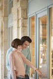 Couple Looking In Shop Window Royalty Free Stock Images