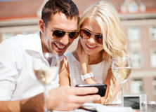 Couple looking at smartphone in cafe Stock Photos
