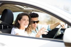 Couple looking at something interesting from their car Stock Photography