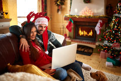 Couple looking something at laptop Stock Photography