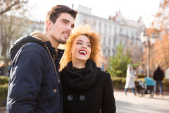 Couple looking on something outdoors Stock Photo