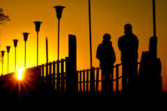 Couple looking sunrise Stock Photos