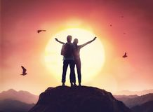 Couple looking at sunset. Toward adventure! Man and woman enjoying journey. Couple looking at sunset stock images