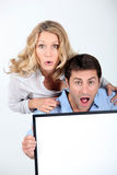 Couple looking surprised Royalty Free Stock Image
