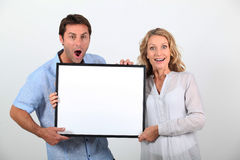 Couple looking surprised Stock Photography