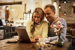 Couple looking at tablet computer together Stock Image