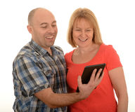 Couple looking at tablet Stock Photography