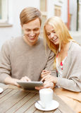 Couple looking at tablet pc in cafe Stock Photo