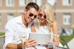 Couple looking at tablet pc in cafe Royalty Free Stock Images