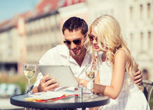 Couple looking at tablet pc in cafe Stock Photography