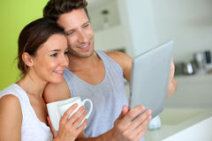 Couple looking at tablet screen Stock Photo