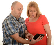 Couple looking at tablet Stock Photos