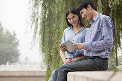 Couple Looking at Tablet Together Royalty Free Stock Photos