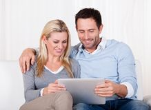 Couple looking at a tablet together Stock Image