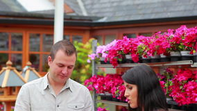 Couple looking at and talking about plant Royalty Free Stock Photography