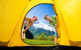Couple looking into tent Stock Photos