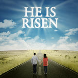 Couple looking at text he is risen Royalty Free Stock Photos