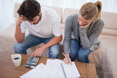 Couple looking at their bills Stock Images