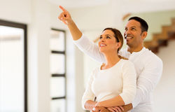 Couple looking their house Stock Images