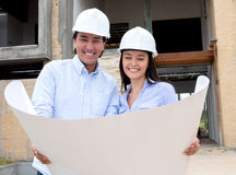 Couple looking at their house design Stock Images