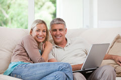 Couple looking at their laptop Stock Photos