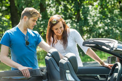 Couple Looking At Their Newly Purchased Car Stock Image