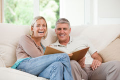 Couple looking at their photo Royalty Free Stock Image