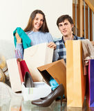 Couple looking their  purchases. In home Royalty Free Stock Photography