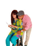 Couple looking at there tablet computer. Stock Photography