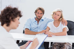 Couple looking thoughtful during a session Stock Photography