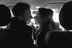 Couple looking to each other in the car Stock Images