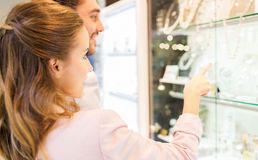 Couple looking to shopping window at jewelry store Stock Images