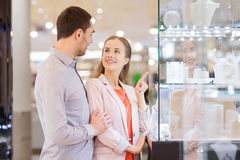 Couple looking to shopping window at jewelry store Stock Image