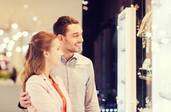 Couple looking to shopping window at jewelry store Stock Photos