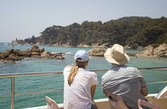 Couple looking to shore from boat Royalty Free Stock Photo