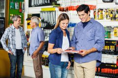 Couple Looking At Tool Set In Hardware Store Stock Images