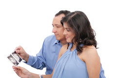 Couple looking at an ultrasound Royalty Free Stock Photos