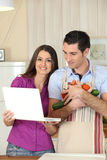 Couple looking-up recipe Royalty Free Stock Image