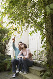 Couple Looking Up On Steps Royalty Free Stock Photography