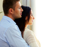 Couple looking at window Royalty Free Stock Image