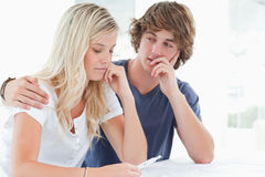 Couple looking worried as the girl holds a pregnancy test Royalty Free Stock Image