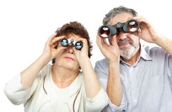 Couple looks through binoculars Stock Photography
